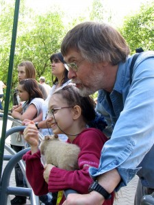 Alex & Lina & the toy capybara watching the real capybaras at the Moscow Zoo.