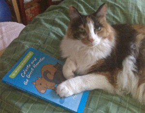 "Emily Cat saying ""Keep your paws off my copy of Celeste and the Giant Hamster."" I'll let you know when I'm done reading it."