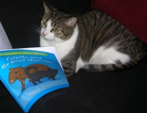 Lauren Thompson's cat Tofutti reading Celeste
