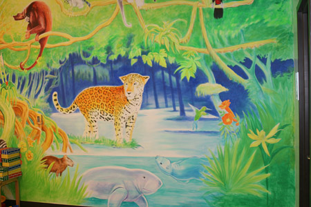 Mural including a capybara in children's section of Georgetown library