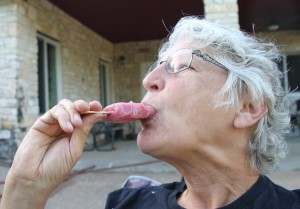 Old woman eating a popsicle