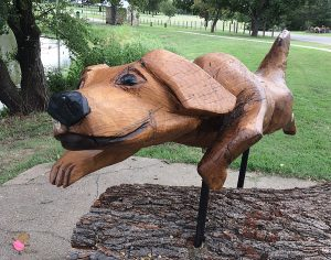 Wooden stature of a dog running