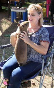 Woman holding baby capybara